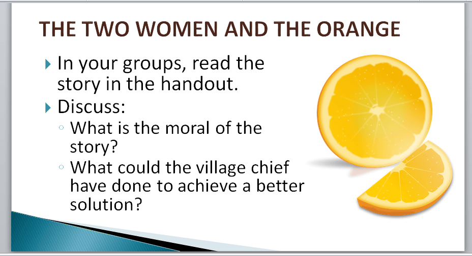 Two women and one orange conflict handling training exercise